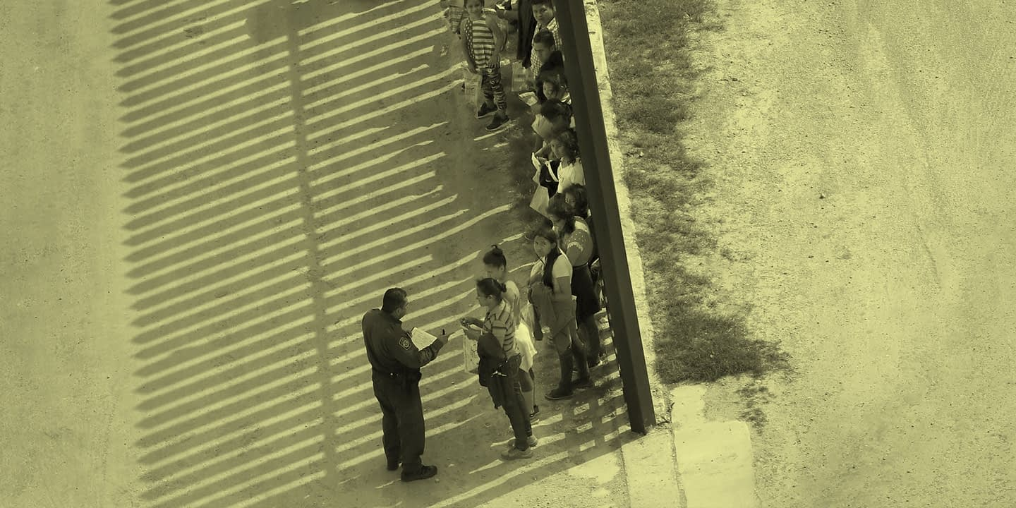 Immigrants wait at the border